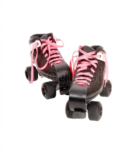 Two roller skates with black boots and pink laces