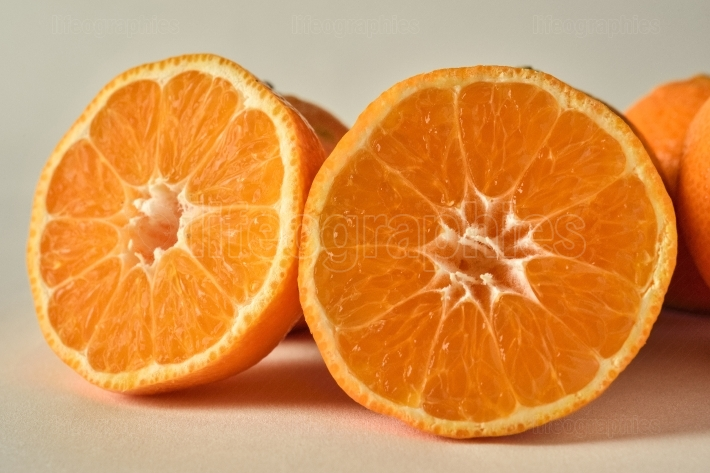 Two sliced oranges