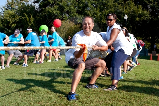 Two Teams Pull Ropes In Adult Tug Of War Fundraiser