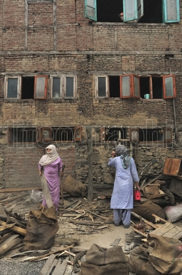 Two women working in the old town of Srinagar