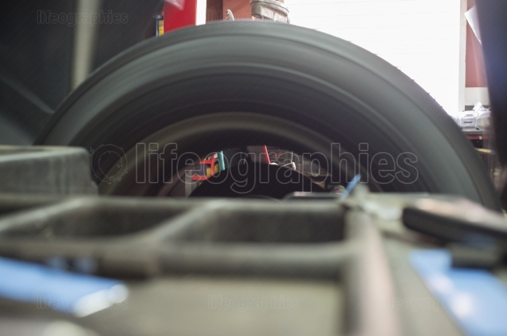 Tyre spinning at mechanic balancing wheel