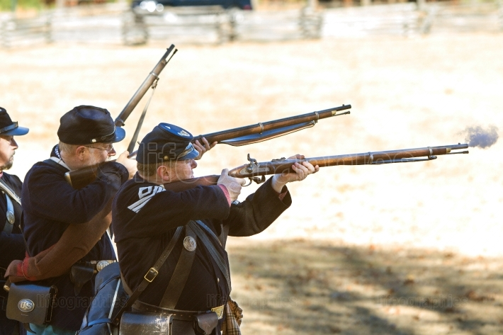 Union army civil war reenactors shoot muskets in firing demonstr