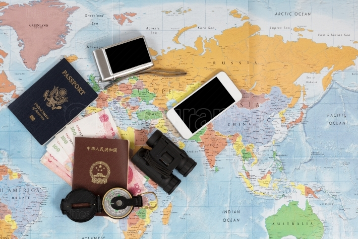 United States and Chinese passports with other travel items