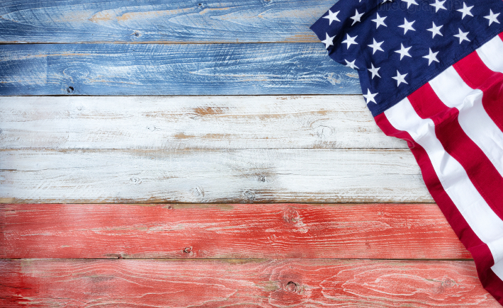 United States flag of America on rustic wooden boards painted in