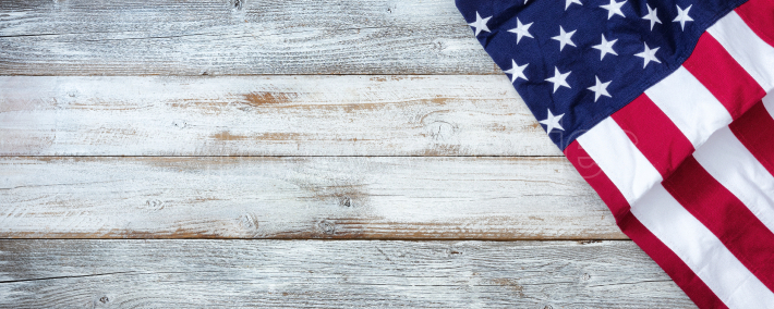 United States flag of America on white rustic wooden background