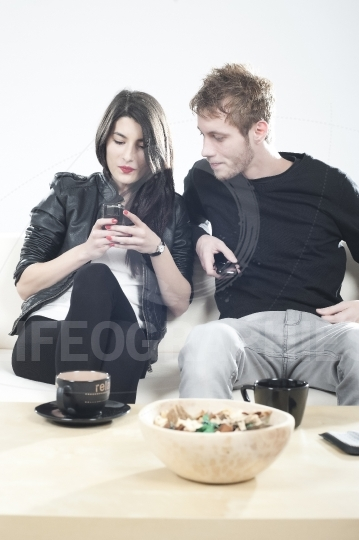 Upset couple looking to mobile phones