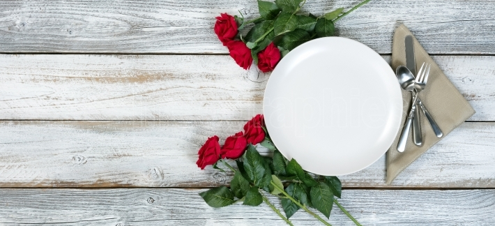 Valentine Dinner table setting on rustic wood background