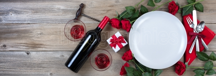 Valentines Dinner with Red Wine on rustic wooden background