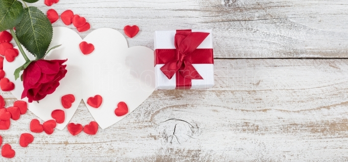 Valentines gift with card on white wood