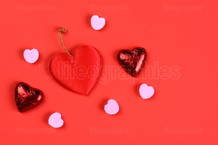 Valentines hearts on red