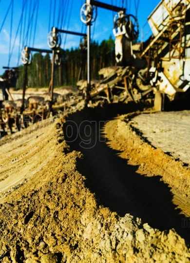 Vertical vivid sand mining machine bokeh background backdrop