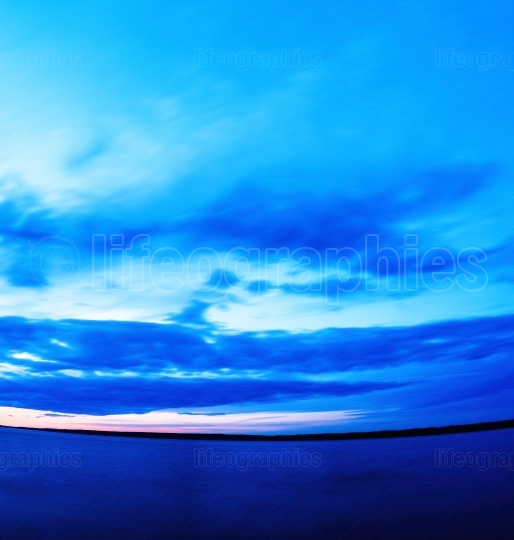 Vertical vivid super wide angle  ocean curved horizon with cloud