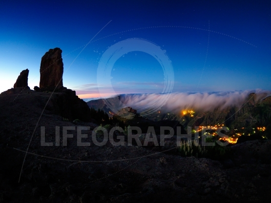 View of Roque Nublo peak and Artenara village by night, Gran Can