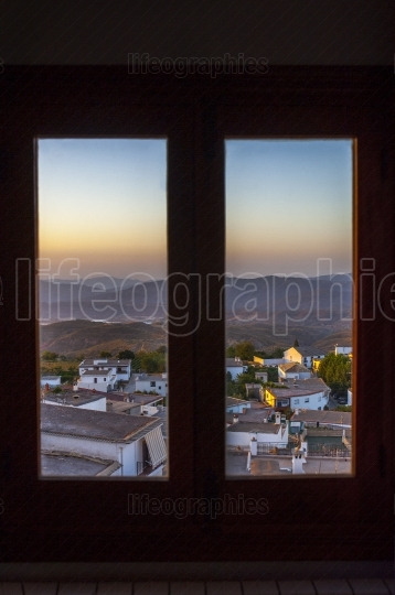 Village of Yegen through the window, Alpujarras mountains, Spain