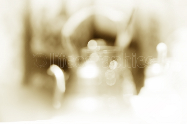 Vintage cafe teapot bokeh background