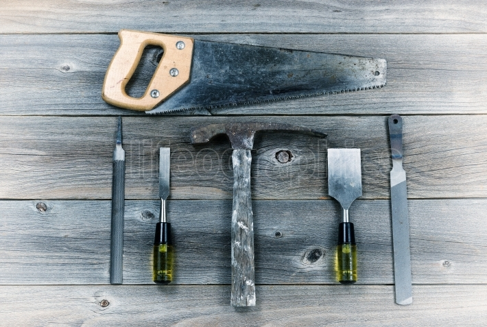 Vintage Hand Tools on Rustic Wooden Boards