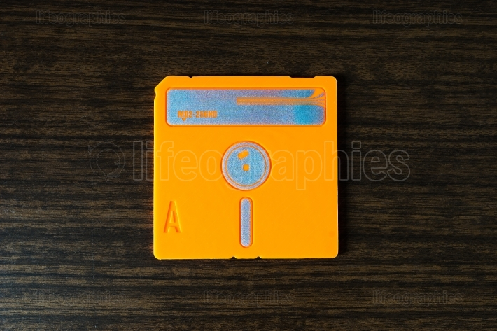 Vintage orange floppy disc background