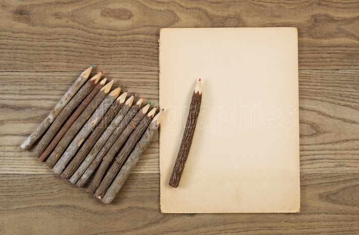 Vintage Pencils and Aged Paper on Rustic Wood