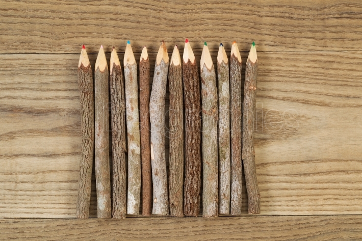 Vintage Pencils placed on Rustic Wood