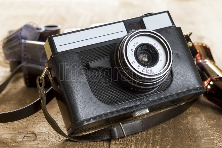 Vintage photo camera and blank film strip