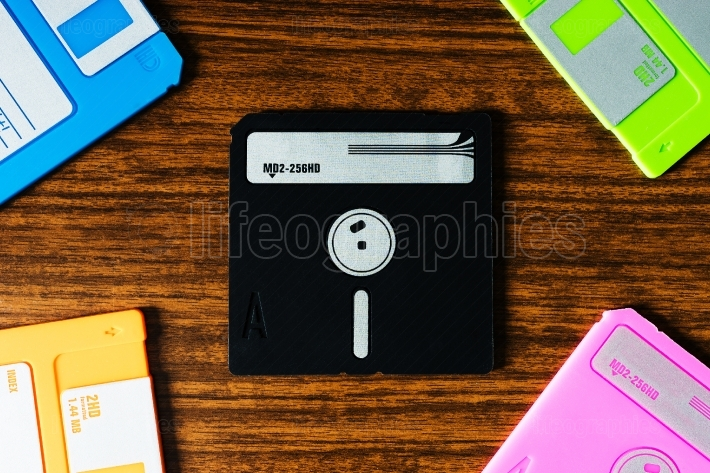 Vintage set of floppy discs on wooden desk background
