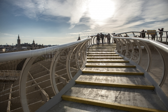 Visitors on the roof footbridge at Metropol Parasol at sunset, S