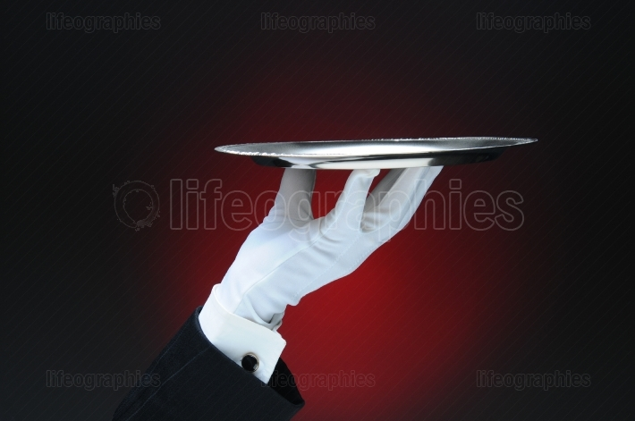 Waiter Holding a Silver Serving Tray in His Fingertips