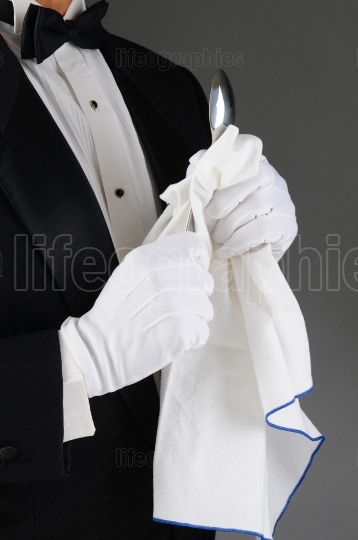 Waiter Polishing Spoon
