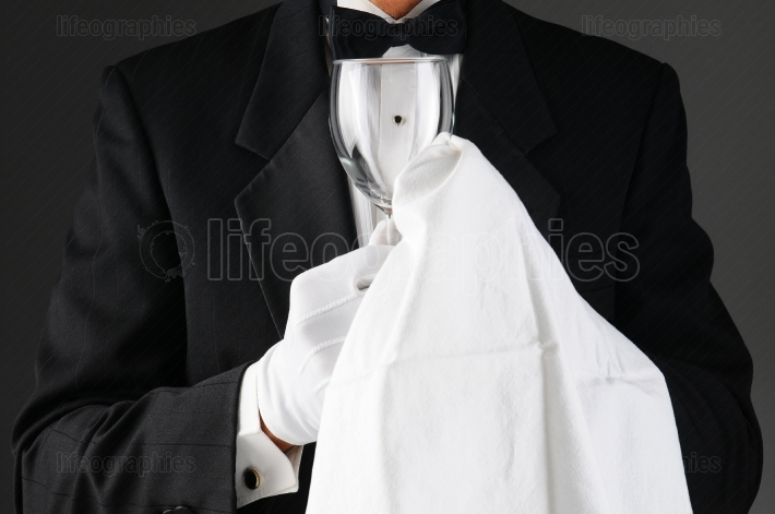 Waiter Polishing Stemware