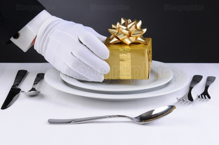 Waiter Setting Present on Plate