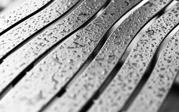 Wavy metal bech with raindrops background