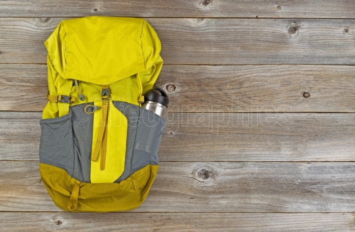 Weather proof backpack for hiking on rustic wooden boards