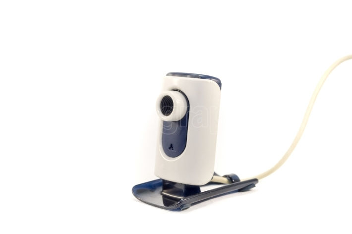 Webcam with little foot and USB cable on a white background