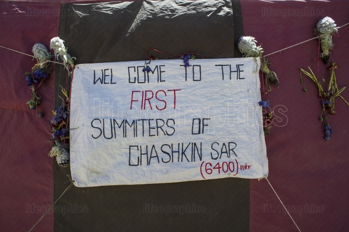Welcome flag for expedition team. Chashkin Sar peak 6.400m