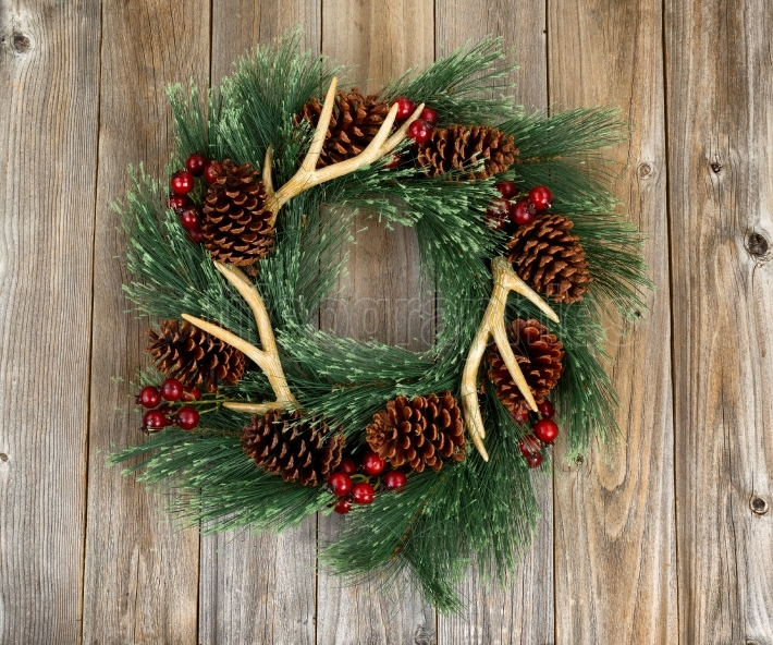 Western style wreath on aged wooden boards