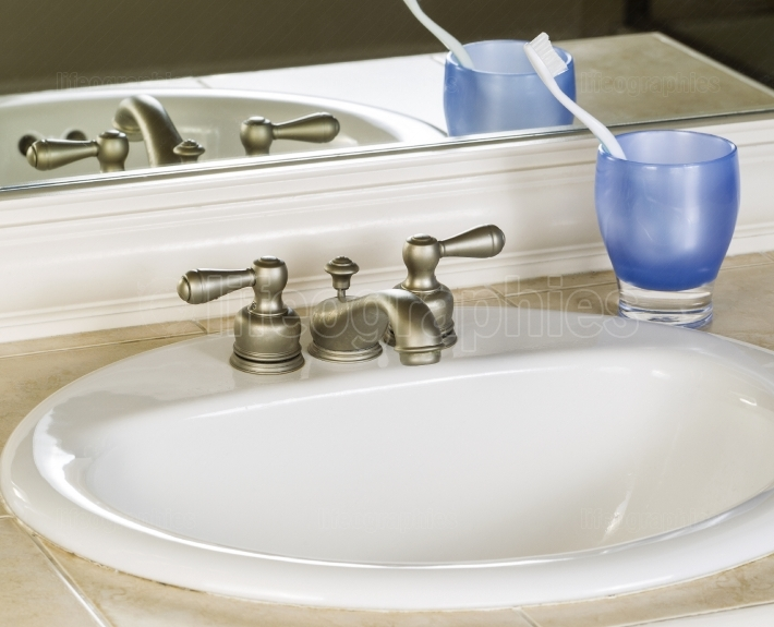 White Bathroom Sink and Faucet