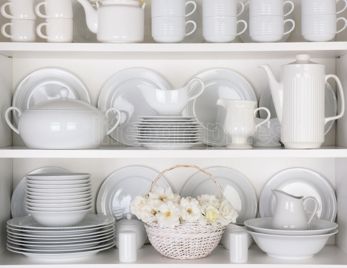 White Plates in Cupboard