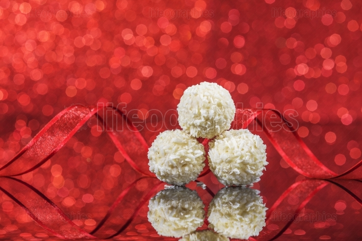 White snowball Chocolate on glass table