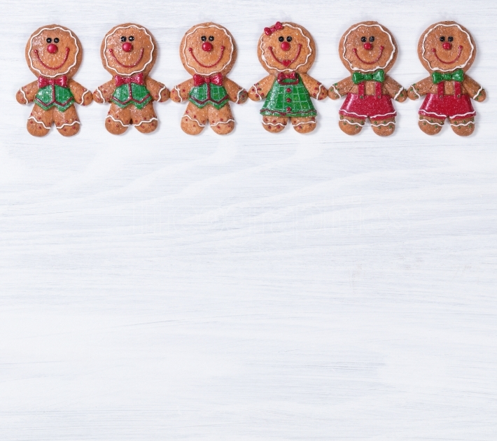White wooden boards with Christmas cookies on upper border