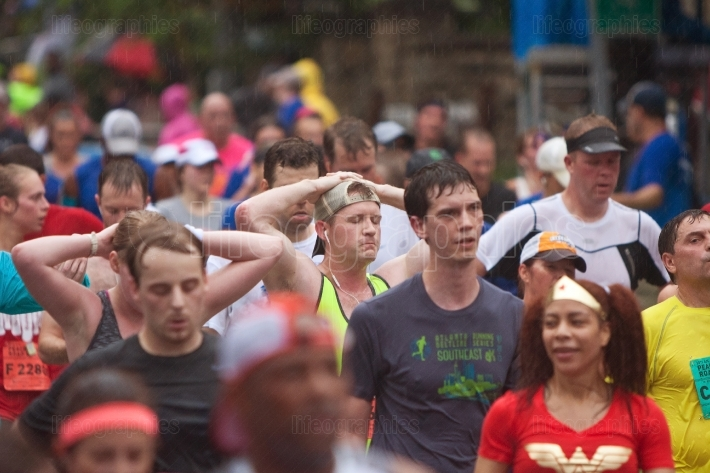 Winded runners recover after finishing atlanta peachtree road ra