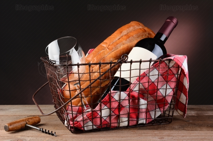 Wine and Bread in Wire Picnic Basket