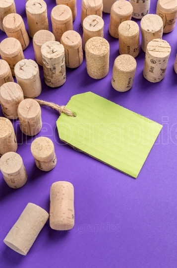Wine cork stoppers with green label on purple background.Useful