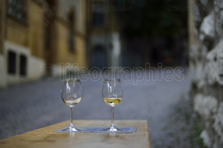 Wine glasses for two lovers on the streets of Neuchatel. Switzerland