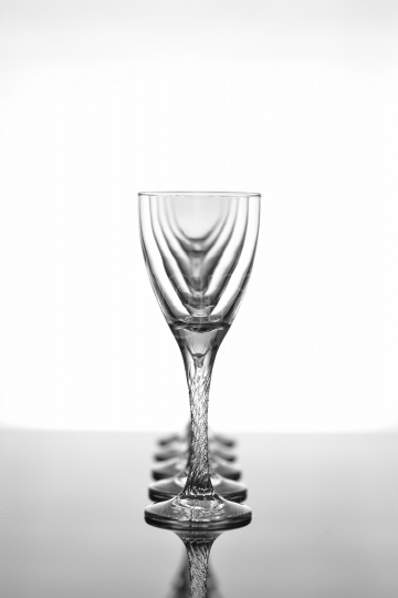 Wine glasses on glossy table surface