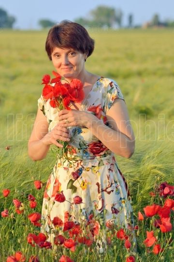 Woman  in field of poppies