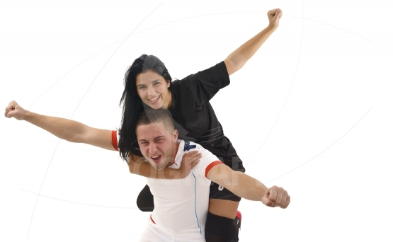 Woman and man happy by scorring goal