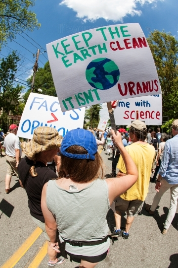 Woman Carries Funny Sign In Earth Day March For Science