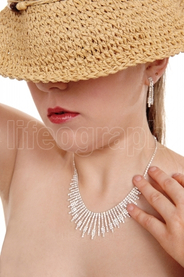 Woman covered eyes with straw hat