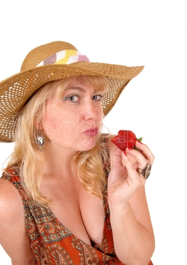 Woman eating strawberry.