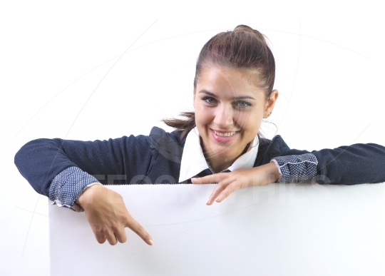 Woman excited pointing on empty blank billboard paper sign board. Young business woman isolated